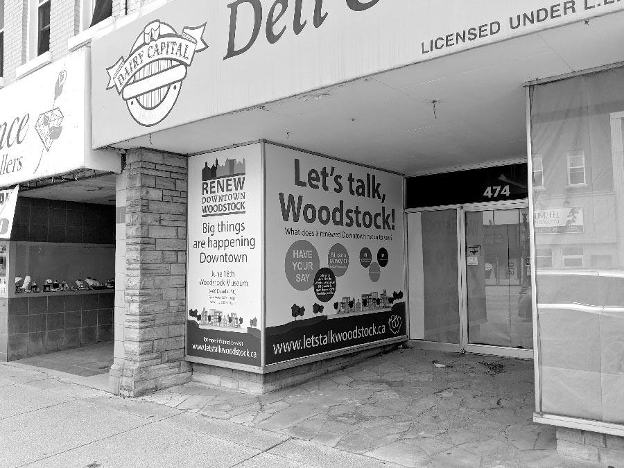 Development Plan notice within downtown Woodstock.
